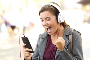 Excited teen listening to music