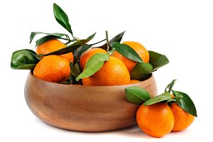 Fresh tangerines with green leaves