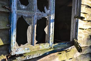 Old Shed With Broken Window