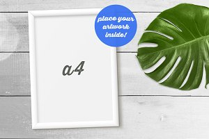 White Frame Mockup w/ Monstera Leaf