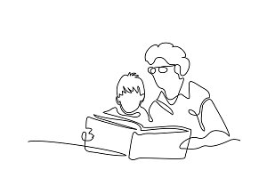 Grandmother with grandson reading book