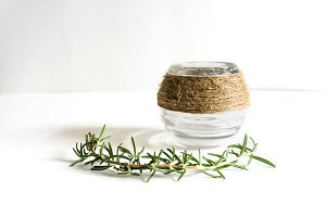 Rosemary and Jar on White Background