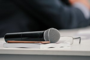 Microphone on table at presentation or business seminar, close up