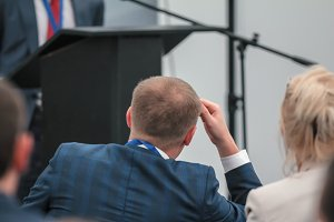 Listener male in suit at the lecture or business workshop, presentation