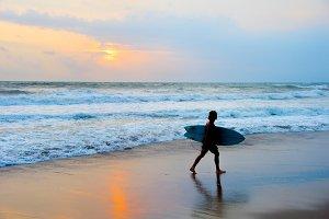 Dreadlocks surfer on the beach
