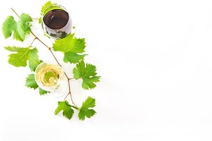 Red white wine glasses green leaves