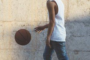 Young Man Holding a Basketball Ball