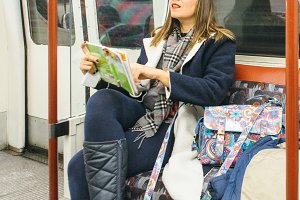 Woman traveling by subway