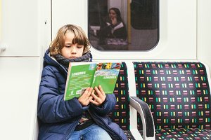 Child reads a travel guide