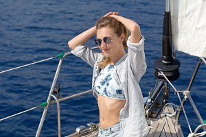 Young blonde woman enjoying sailing