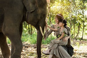 beautiful women and elephants