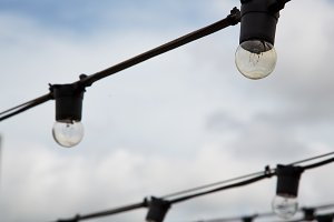 string wired bulbs on outdoor field
