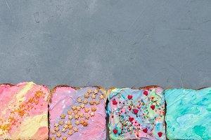Four Unicorn Toasts on a gray concrete texture background