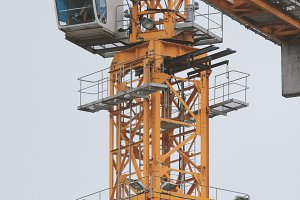 Construction crane - metal structure and cabin, vertical