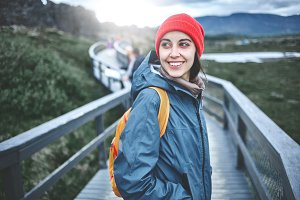 young woman hiker hiking in beautiful mountains in Thingvellir valley