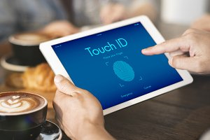 Hands working on tablet touch ID