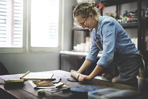 Woman working in a pottery studio