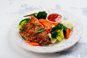 Fried pork steak with vegetables garnish