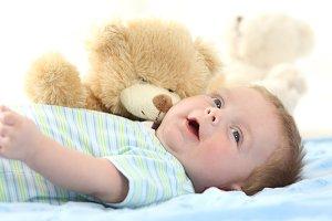 Happy baby and teddy bear