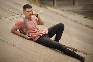 Guy rests on concrete slabs