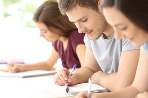 Close up of three students studying