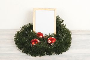 Photo frames next to christmas decoration on wooden table. Decor.