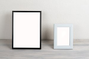 Photo frames on wooden table. Decor.
