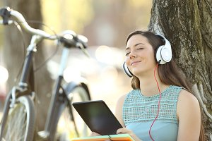 Student listening to music on line