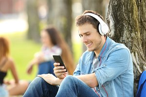 Student listening music with phones