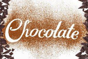 The word Chocolate written by cocoa powder with dark chocolate
