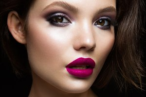 Beautiful young model with pink lips