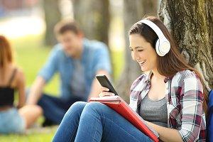 Student listening on line tutorials