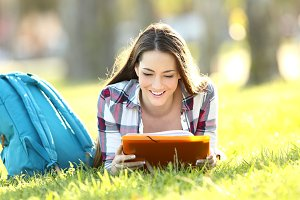 Student girl reading paper notes