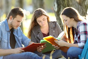 Students studying memorizing notes