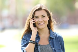 Teen walking and calling on phone