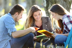 Students studying together outdoors