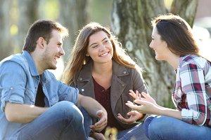 Three happy friends talking
