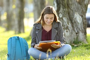 Student girl studying reading notes
