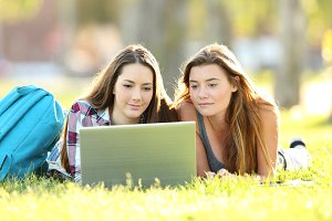 Two students learning on line