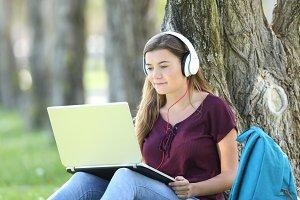 Teen watching video tutorials
