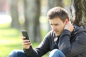 Sad teen reading negative messages