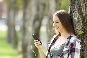 Happy teen listening to music