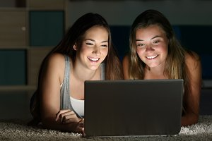 Two teens watching on line content