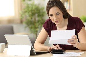 Attentive woman calculating