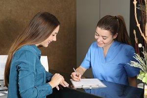 Nurse or dentist attending a client