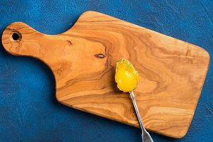 Organic honey on silver spoon