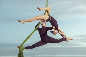 Two women are air gymnasts.
