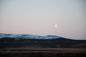 Moon Rising over Vast Landscape