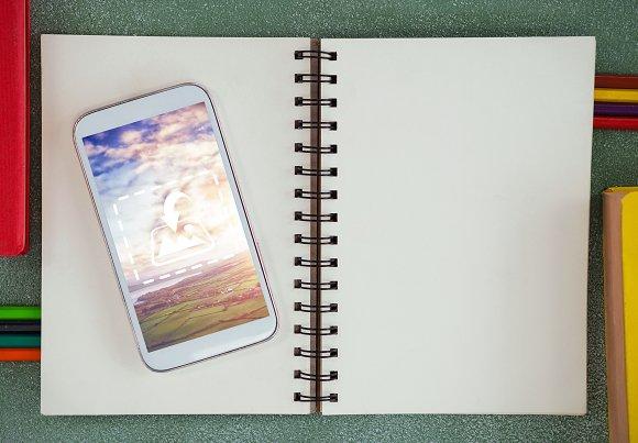 Phone On Book Mockup