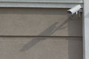 Big CCTV Camera on the wall of building - telephoto